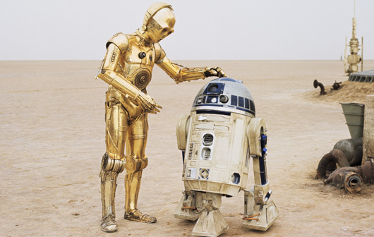 R2d2 And C3po Desert C3PO with golden leg o...