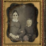 Portrait of blind woman (wearing dark glasses) and child, ca. 1855