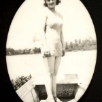 Woman in boat wearing bathing suit and high heels