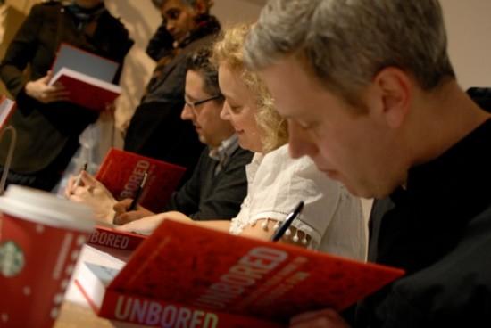 From left: Joshua Glenn, Elizabeth Foy Larsen, Tony Leone signing copies of UNBORED in 2012.