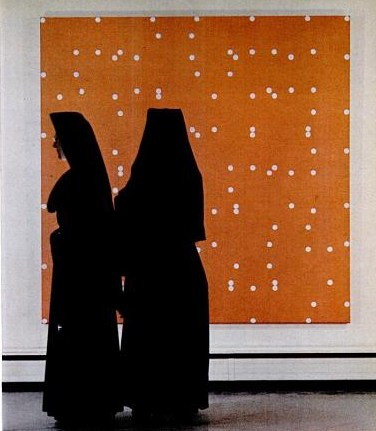 Nuns standing in front of a Poons painting, c. 1963