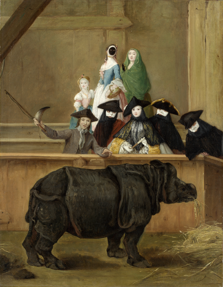 Black rhino munching hay with a small audience wearing hats, capes, and Venetian masks, with a man holding the rhino's horn and a whip gesticulating for the audience.